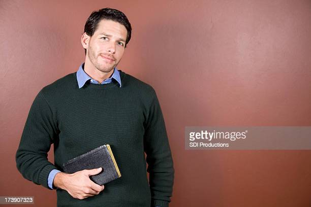 Young Man Holding Bible With Copy Space