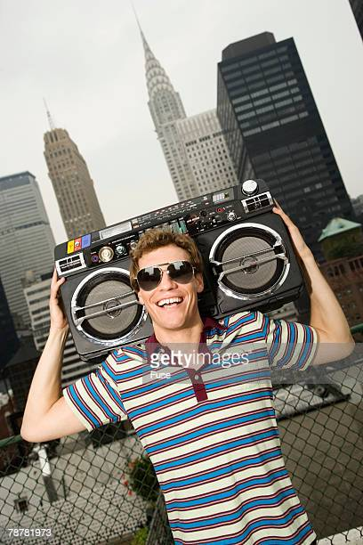Young Man Holding Boom Box