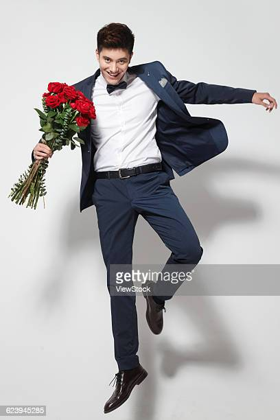 Young man holding bouquet