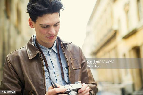 Young man holding camera