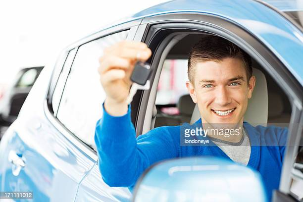 Young Man Holding Car Key