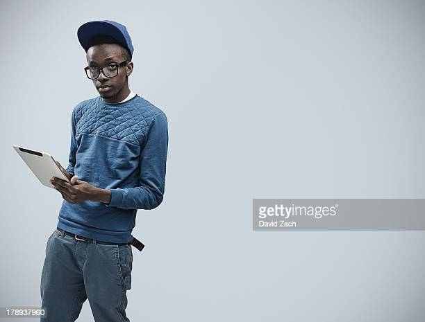 Young man holding digital tablet