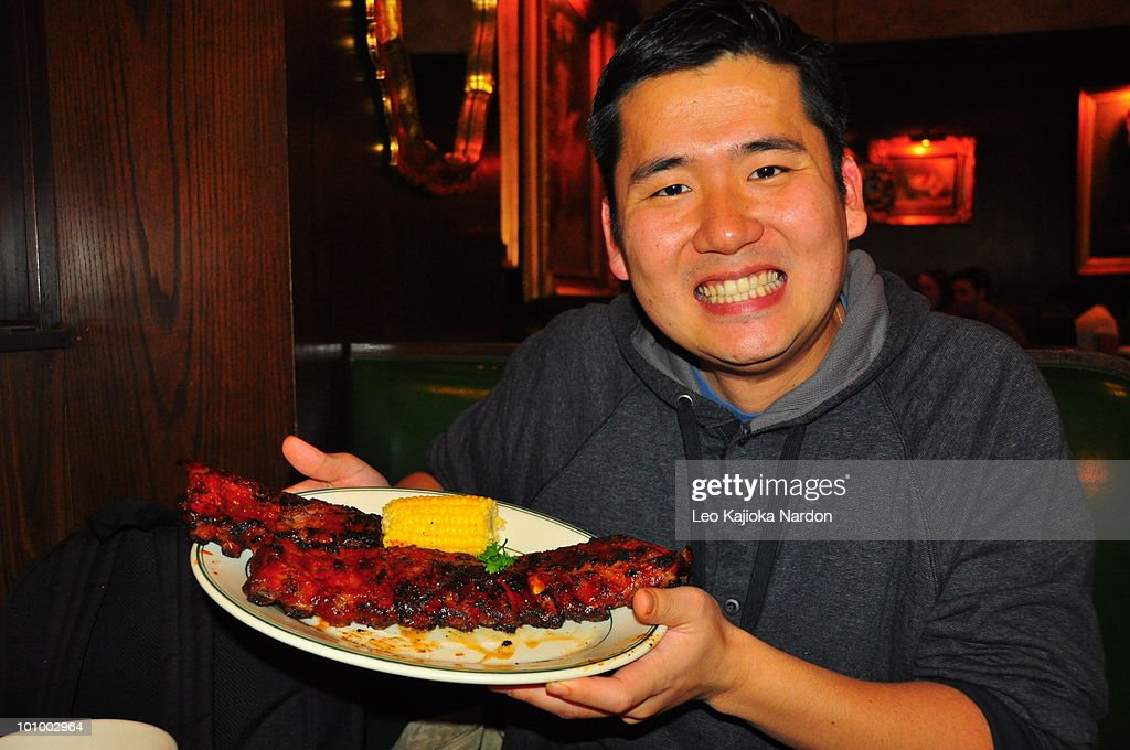 A young man holding dinner : Stock Photo