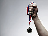 Young man holding medal, close-up