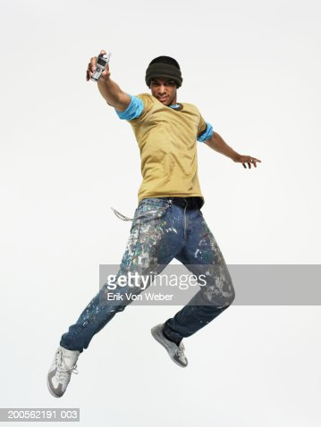 Young man holding mobile phone : Stockfoto