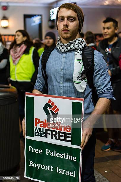A young man holds a banner supporting Palestine at a ProPalestine protest against the Israeli Film Festival in Sydney as part of the boycott towards...