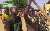 A young man holds a piece of wood during a demonstration in Gao on July 12 2016 against the 'injustices' in the implementation of agreements intended...