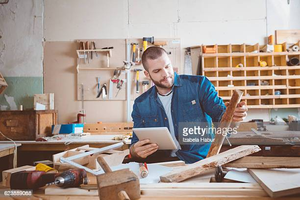 Young man in a carpentry workshop