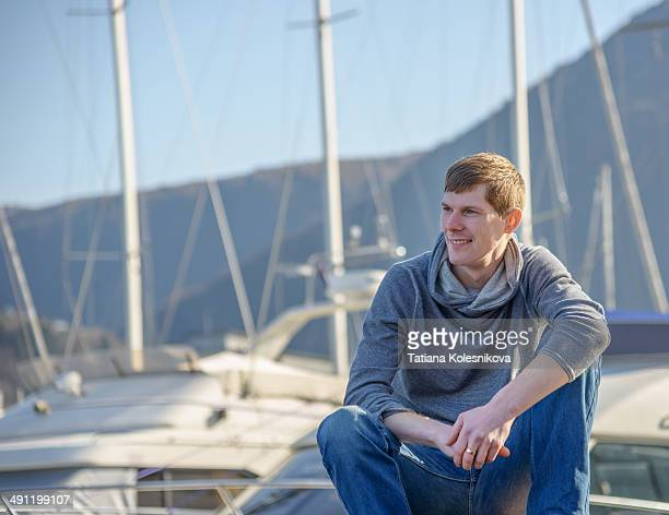 Young man in a marina