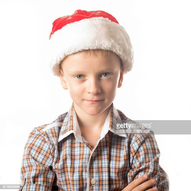 A young man in a Santa Claus hat.