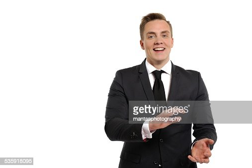 Young man in a suit clap his hands. : Stock Photo