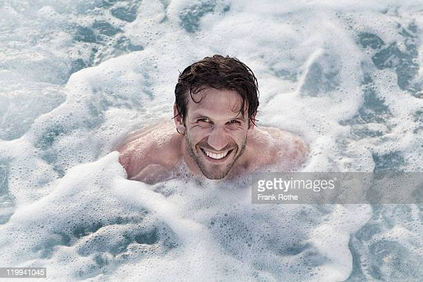 young man in a whirlpool enjoying his bath