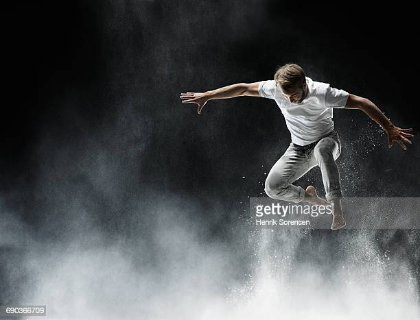 young man in air with white powder