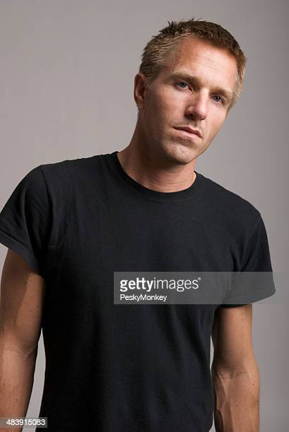 Young Man in Black T-Shirt Looks at Camera Bad Attitude