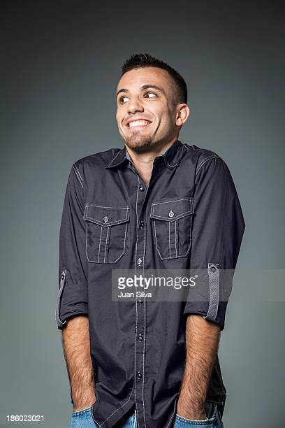 Young man in blue jeans and button down shirt