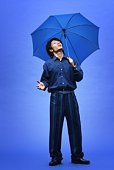 Young Man in Blue Under Umbrella, Front View