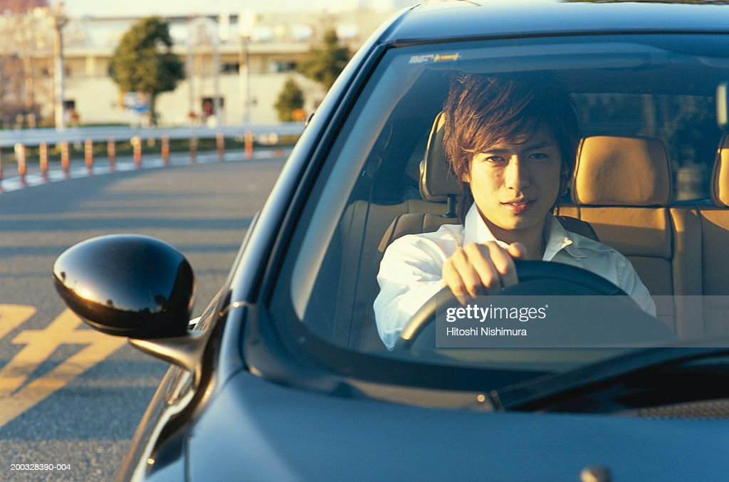 Young man in car, portrait