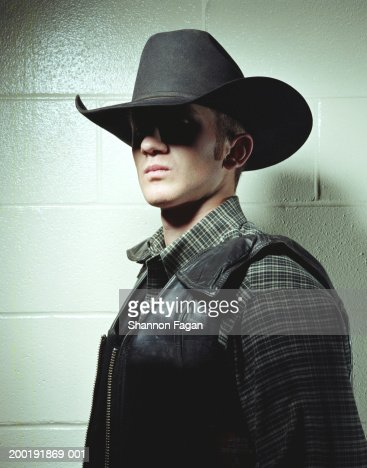 Young man in cowboy hat and leather vest, portrait