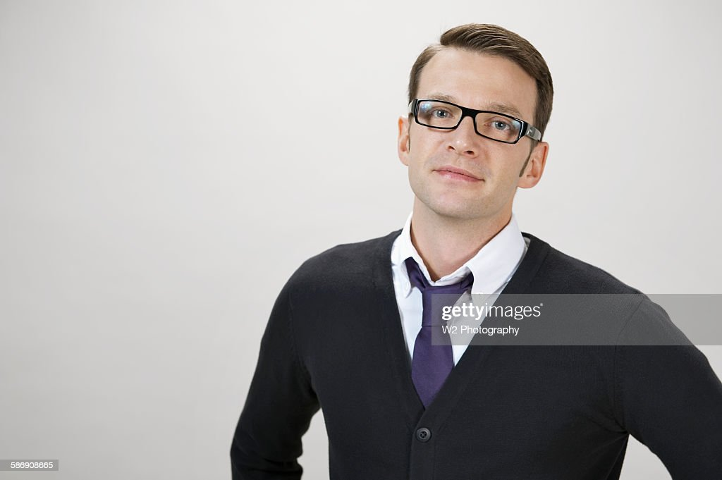 Young man in eyeglasses and cardigan