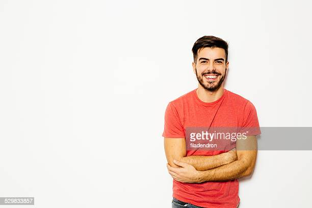 Young man in front of  white background