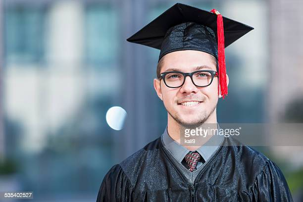 Young man in graduation cap and gown