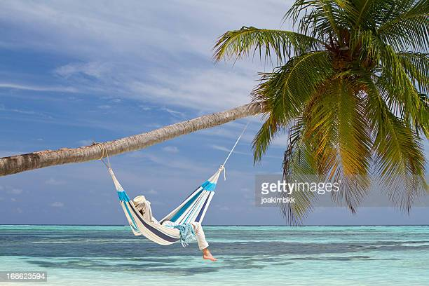 Young man in hammock contemplating the sea