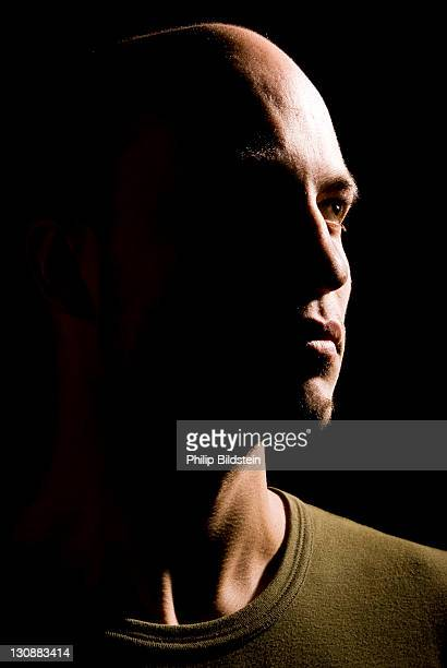 Young man in hard side light, portrait