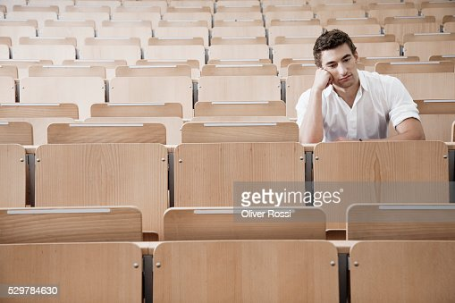 Young man in lecture hall : Stock-Foto