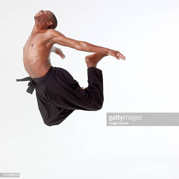 Young man in mid air
