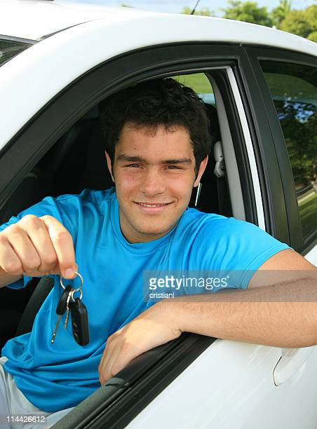 young man in new car