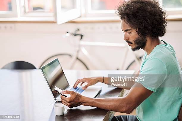 Young man in office using laptop