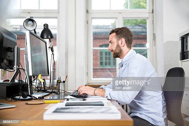 Young man in office working on computer