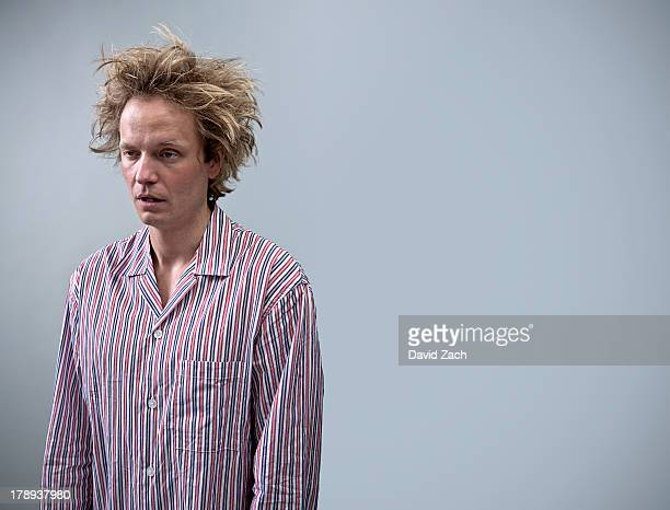 Young man in pajamas looking tired
