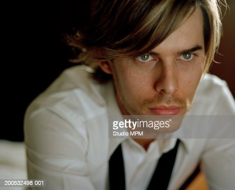 Young man in shirt with tie undone : Stock Photo