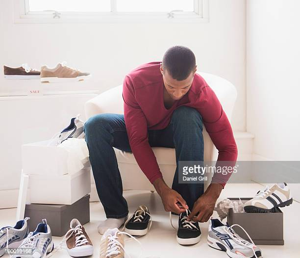 Young man in shoes store