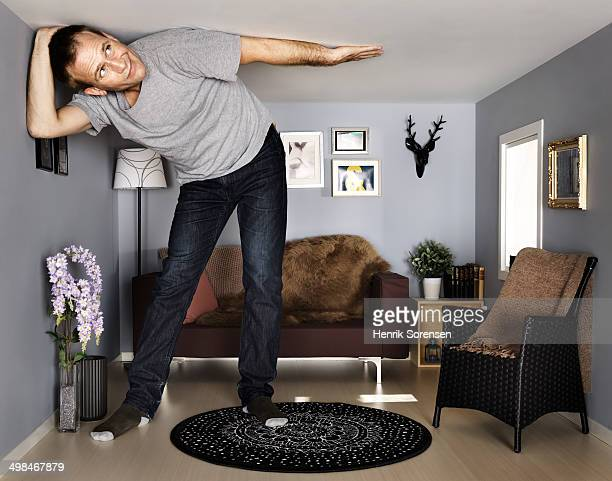 young man in small scale livingroom