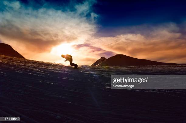 Young man in sunset Powder snow