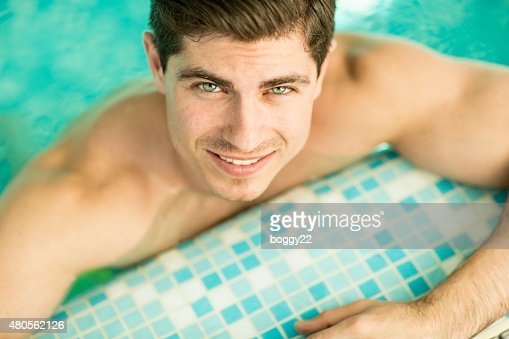 Young man in the pool : Stock Photo