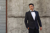 Young Man modeling tuxedo in urban location