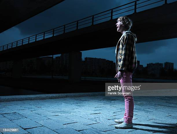 young man in urban environment, surprised