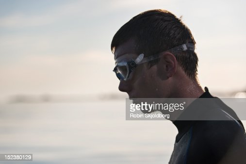 Young man in wetsuit with swimming goggles : Stock Photo