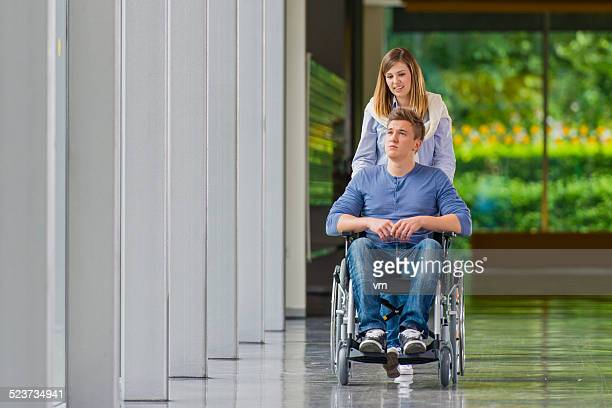 Young Man in Wheelchair talking with Girlfriend