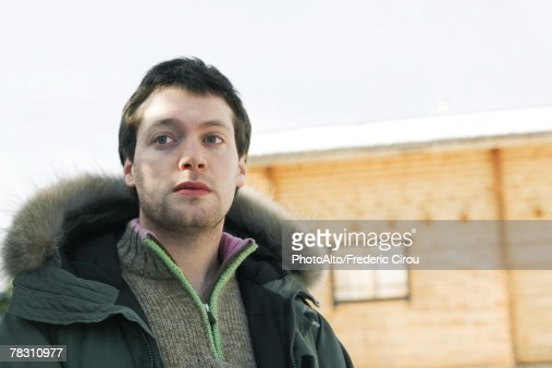 Young man in winter clothing, low angle view