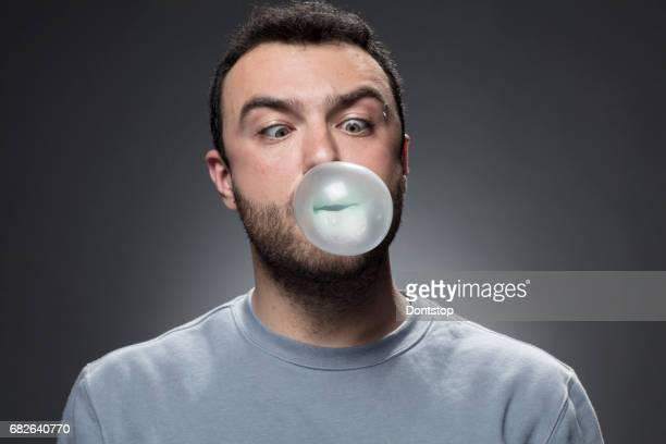 Young Man inflating the bubble