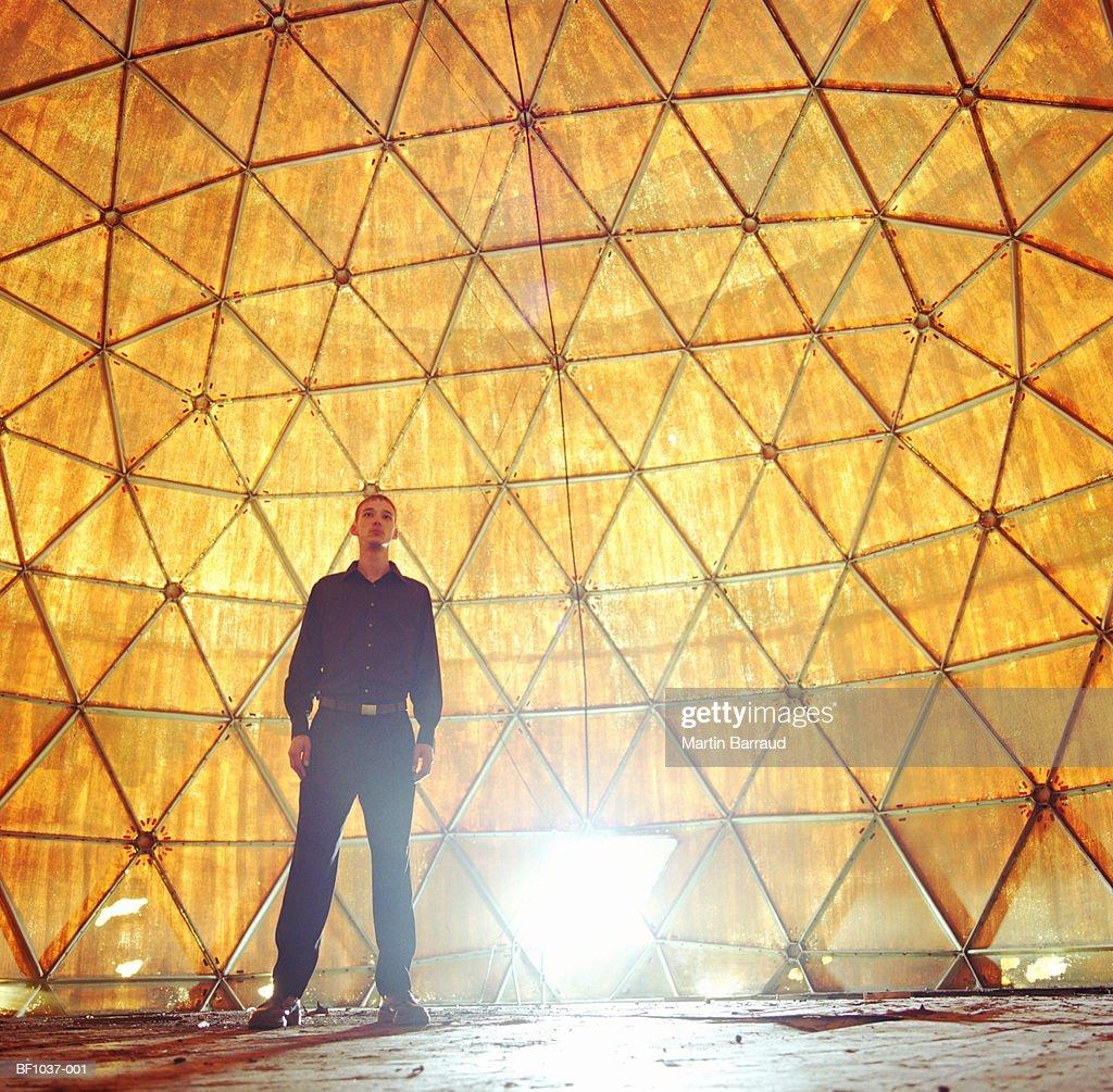 Young man inside radome of radar station : Stock Photo