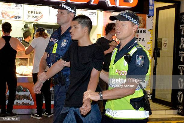 A young man is arrested by Police during Australian 'schoolies' celebrations following the end of the year 12 exams on November 28 2014 in Gold Coast...