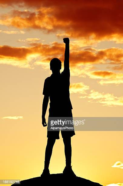 Young man is punching air in celebration, sunset scenery (IV)