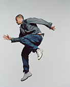 Young man jumping in mid-air, side view