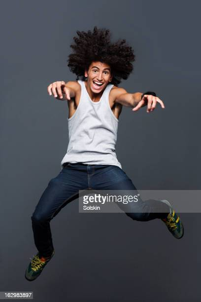Young man jumping, studio background