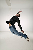 Young man jumping up for joy, portrait